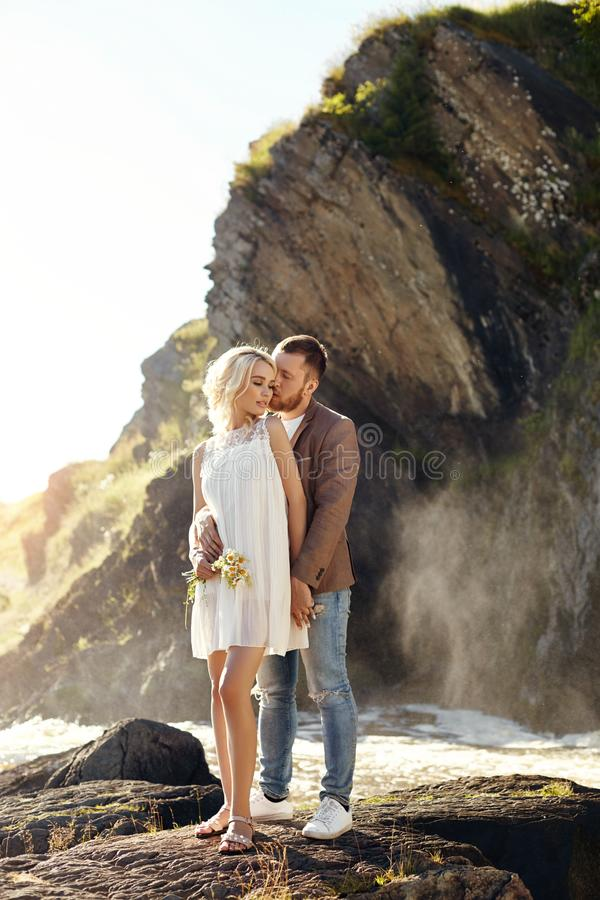 Free Man And Woman Love And Hugs, Close Relationship And Love, Couple In Love Standing On The Rocks Near The River Kissing And Cuddling Royalty Free Stock Photography - 130623717