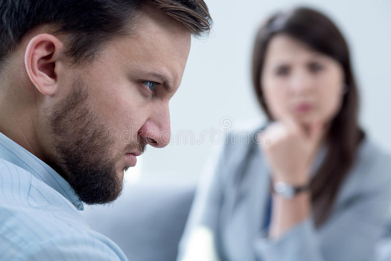 Man with anger. Young men with internal anger on psychotherapy stock images