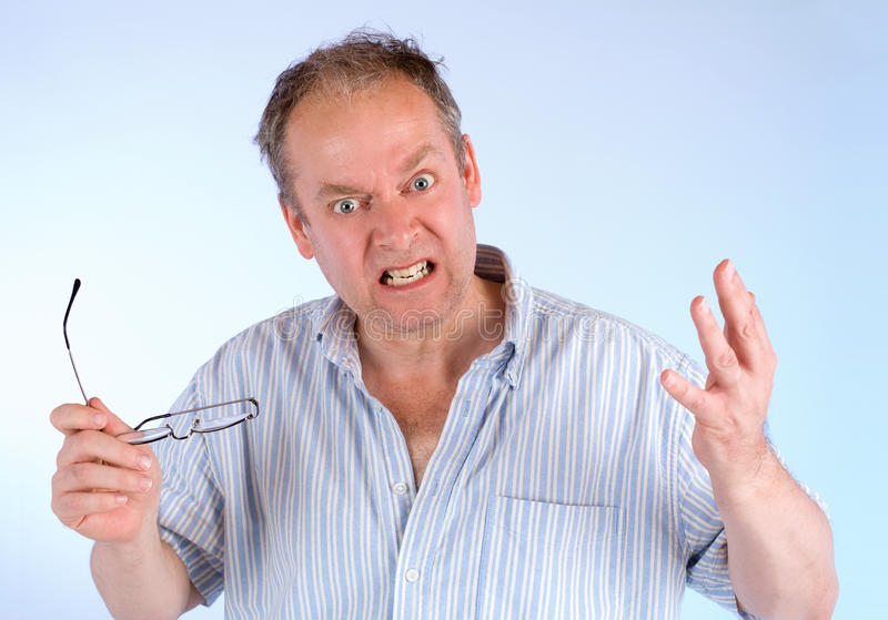 Man Angry about Something. A man is showing his anger about something royalty free stock images