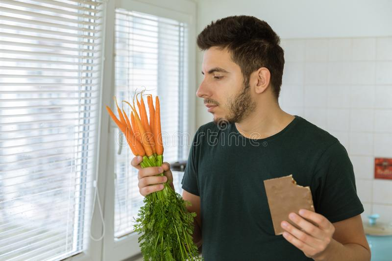 The man is angry and upset, he does not want to eat vegetables. He wants to eat chocolate stock images