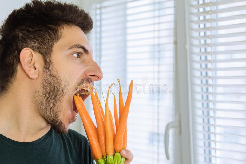 The man is angry and upset, he does not want to eat vegetables. He wants to eat chocolate stock photos