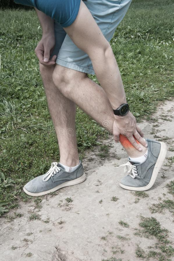Man ankle pain, injury after running stock photo