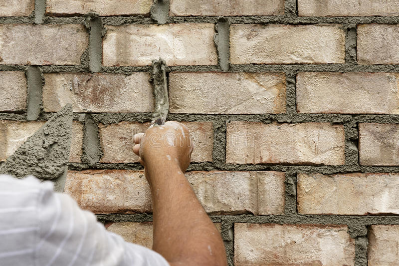Man applying mortar stock photos