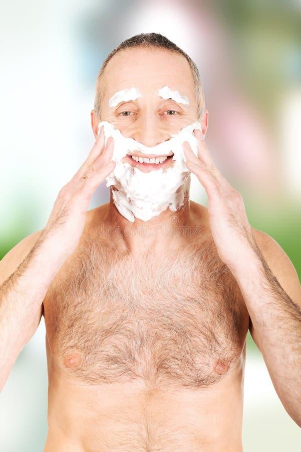 Man applying shaving foam royalty free stock image