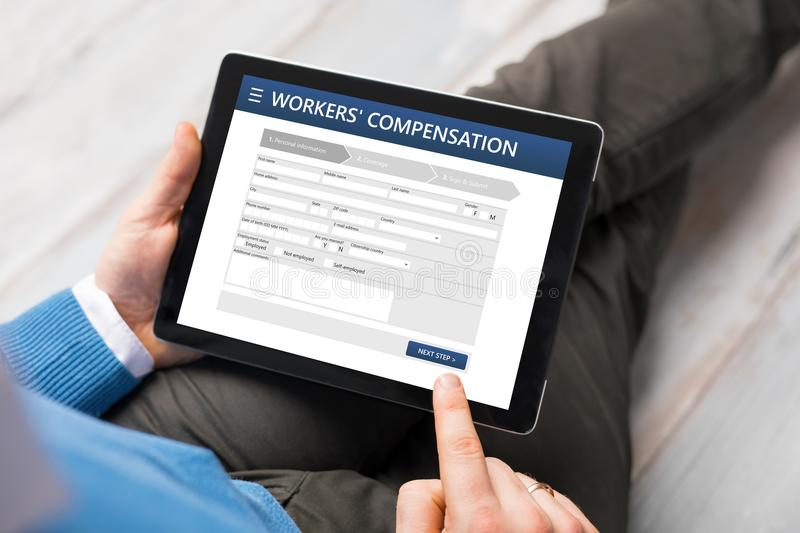 Man applying for workers compensation stock photo
