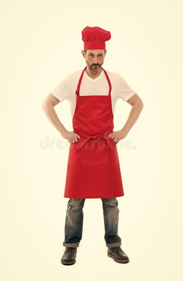 Man in apron. Confident mature handsome man white background. Cooking as professional occupation. Uniform for cooking royalty free stock photos