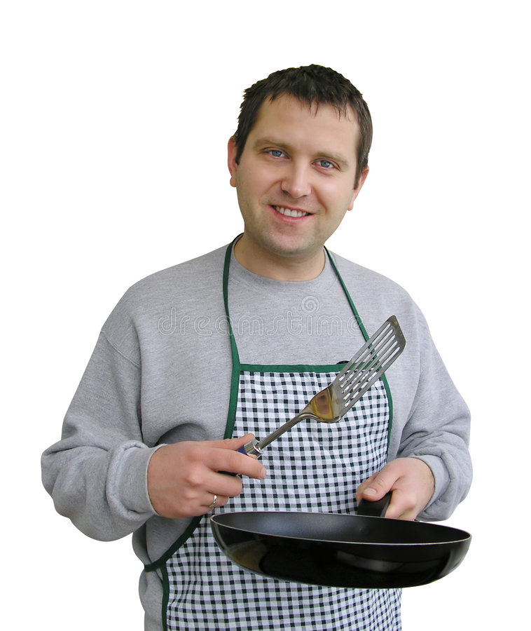 Man in apron cooking stock photo