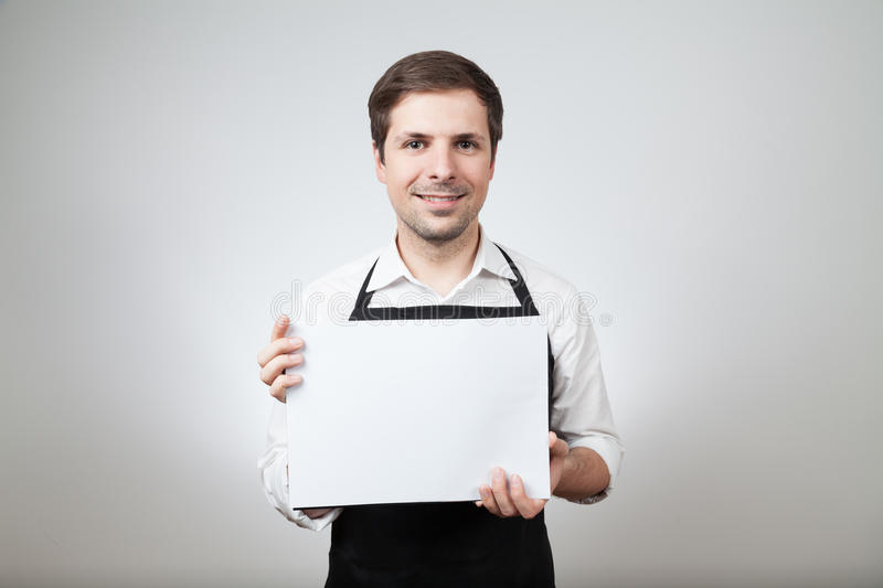 Man with apron and whiteboard royalty free stock images