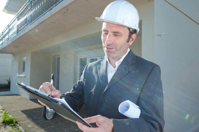 Man architect in helmet working outdoors. Man stock image