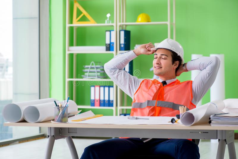 The man architect working on the project. Man architect working on the project royalty free stock images
