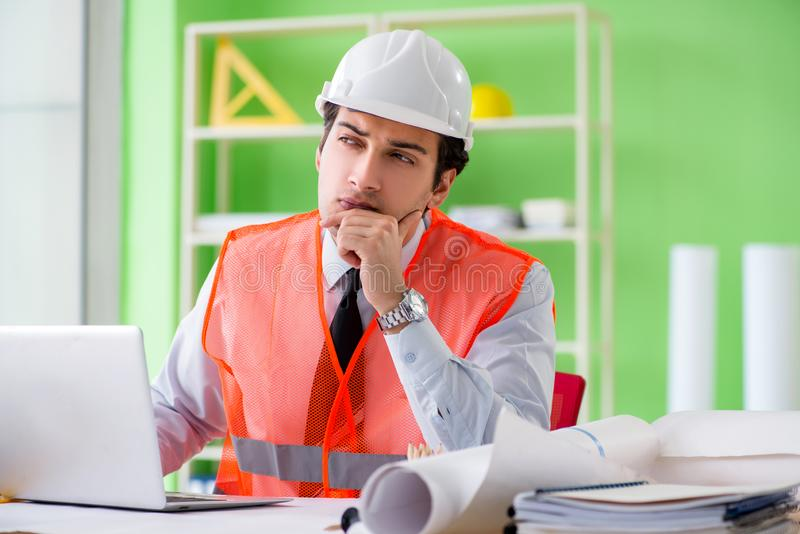 Man architect working on the project. Office stock image
