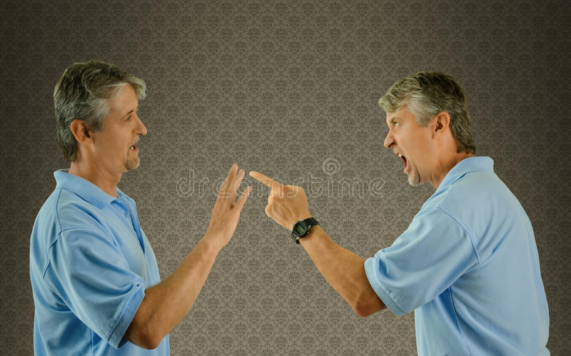 Man arguing w himself guilt and mental illness royalty free stock photo