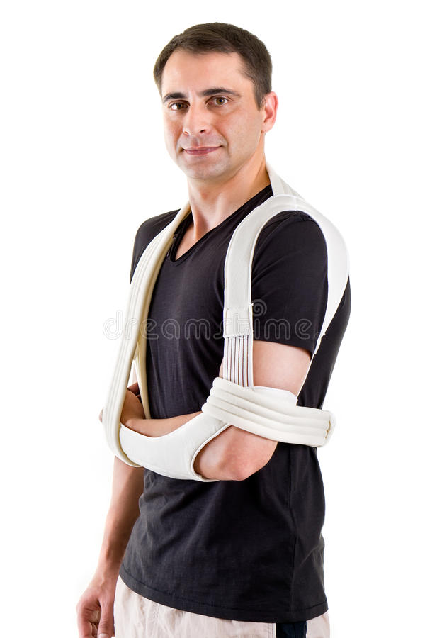 Man with Arm Supported in Sling in White Studio stock photo