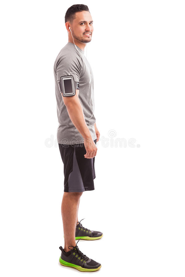 Man with an armband and earbuds royalty free stock photos