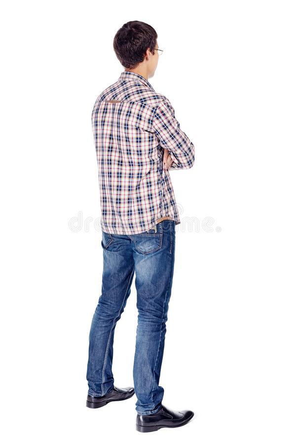 Man with arms crossed full body. Full body half turn back view portrait of smiling young man with crossed arms on his chest wearing metal frame glasses royalty free stock images