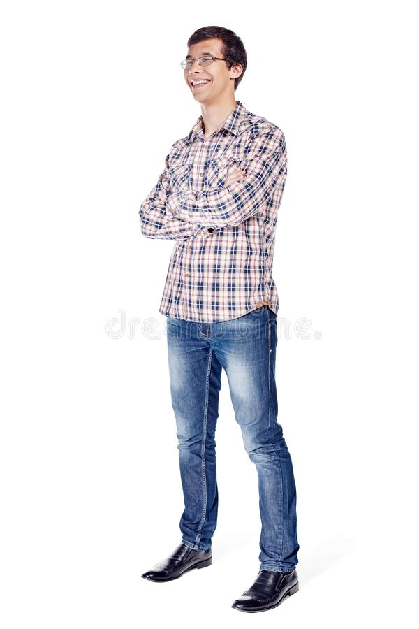 Man with arms crossed full body. Full body half turn view portrait of smiling young man with crossed arms on his chest wearing metal frame glasses, checkered royalty free stock photos