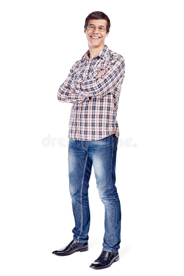 Man with arms crossed full body. Full body half turn view portrait of smiling young man with crossed arms on his chest wearing metal frame glasses, checkered royalty free stock photo