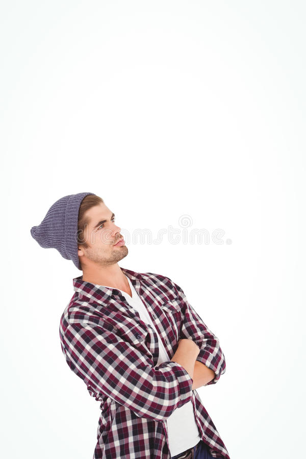 Man with arms crossed looking up. Standing against white background stock photos