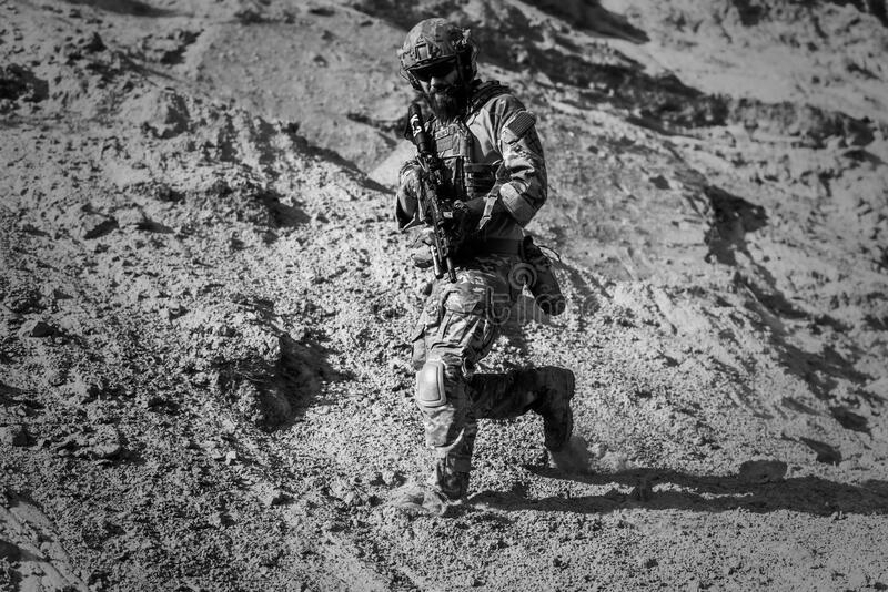 Man In Army Full Combat Uniform Carrying Rifle Free Public Domain Cc0 Image