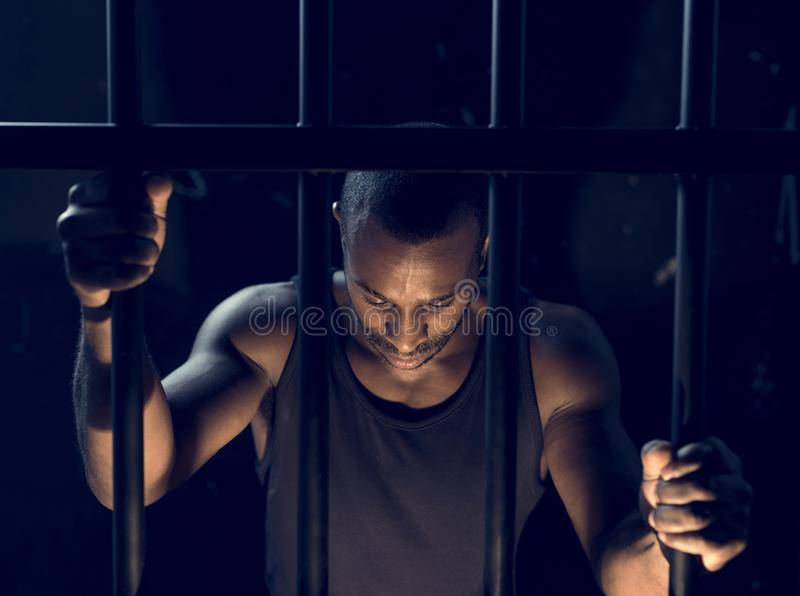A man arrest in the jail royalty free stock image