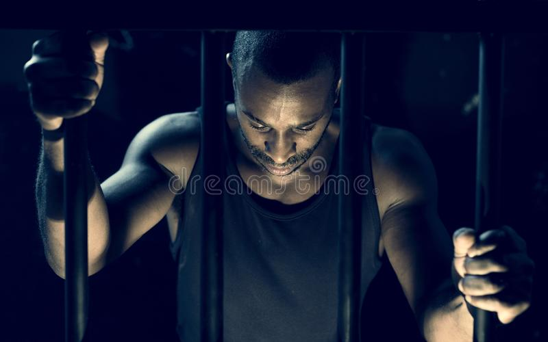 A man arrested in the jail royalty free stock image