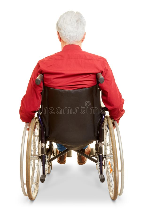 Man as a wheelchair user from behind. Isolated against a white background royalty free stock photos