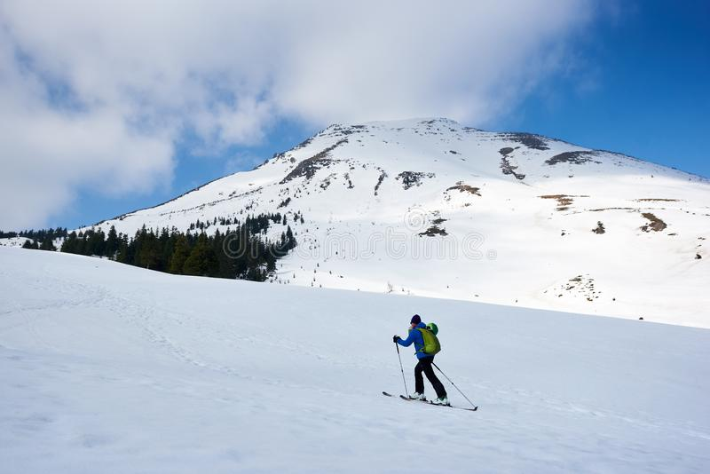 Man ascending during ski touring in the spectacularly white mountains stock photos