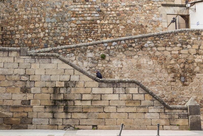 Man Ascending stone steps at Plasencia old town, Spain. Plasencia, Spain - February 15, 2017: Man Ascending stone steps at Plasencia old town, Caceres stock images