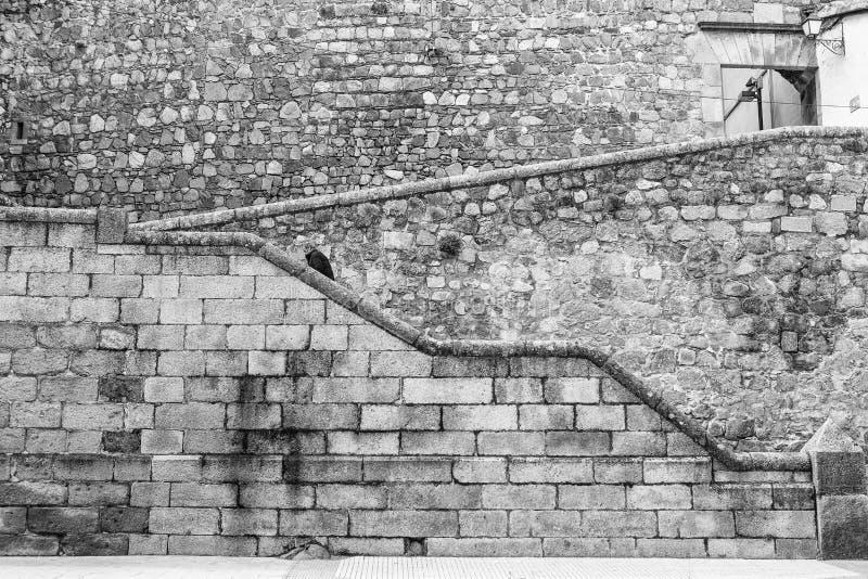 Man Ascending stone steps at Plasencia old town, Spain. Plasencia, Spain - February 15, 2017: Man Ascending stone steps at Plasencia old town, Caceres royalty free stock photo