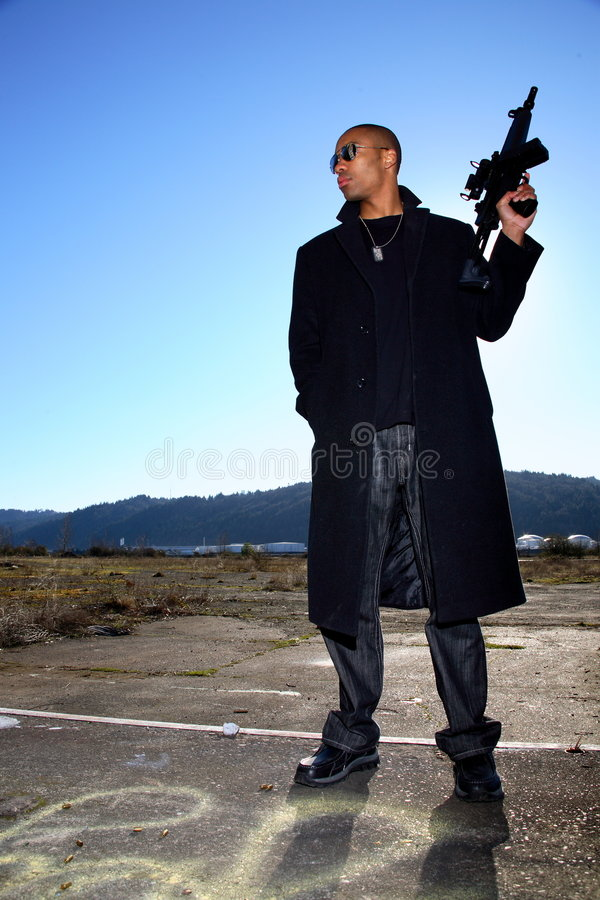 Man with assault rifle stock photo