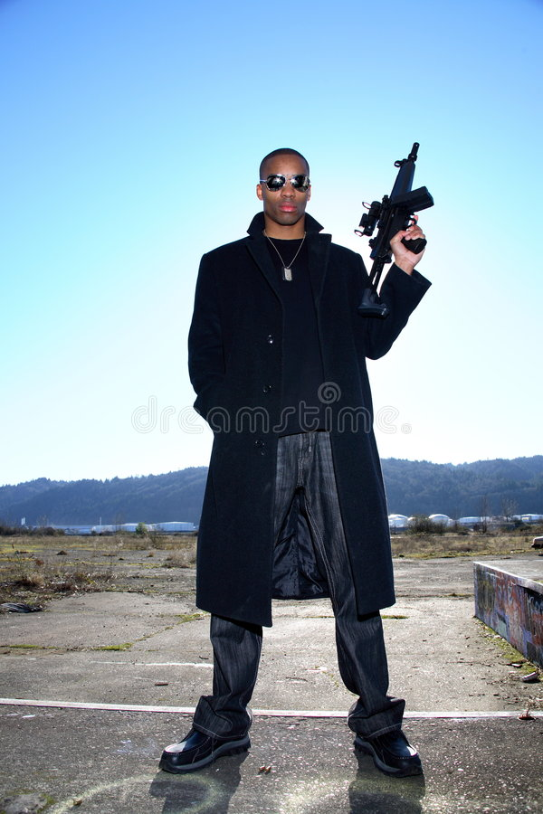 Man with assault rifle stock photography