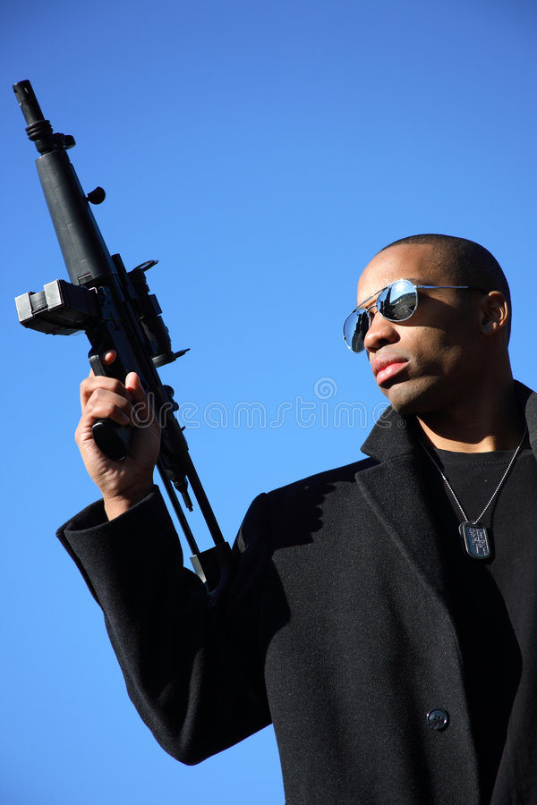 Download Man with assault rifle stock image. Image of blackwater - 4100475
