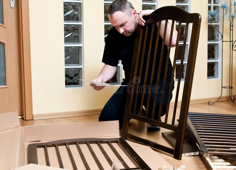 Download Man assembles a baby crib stock photo. Image of panels - 13374860