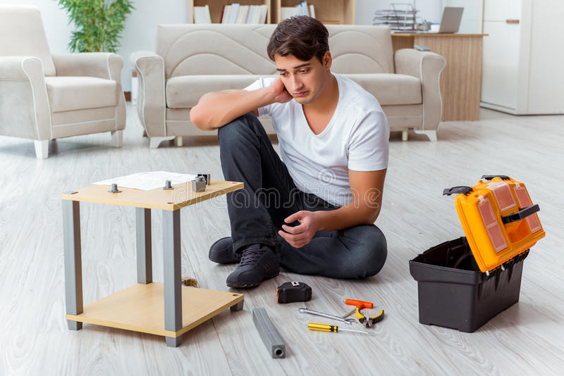 The man assembling furniture at home royalty free stock photography