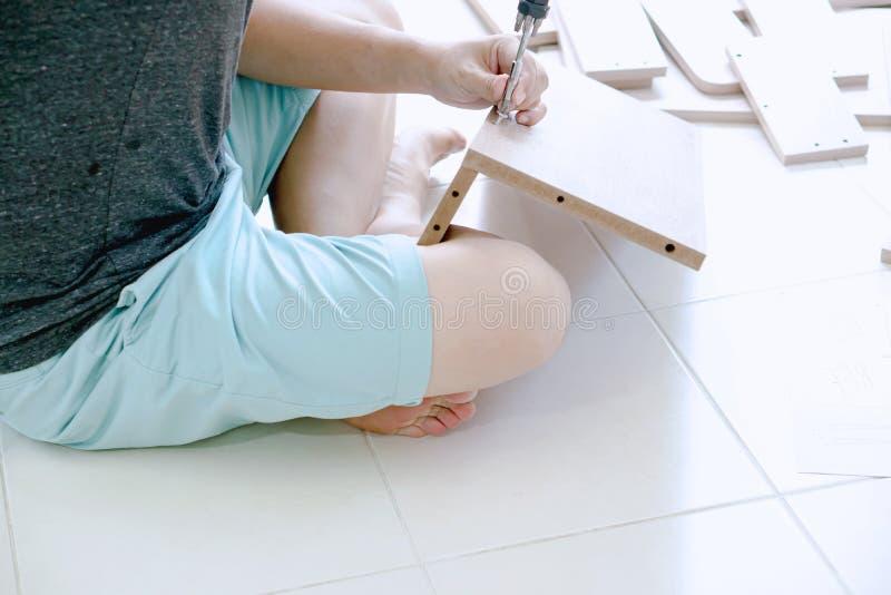 Man assembling furniture at home royalty free stock photo