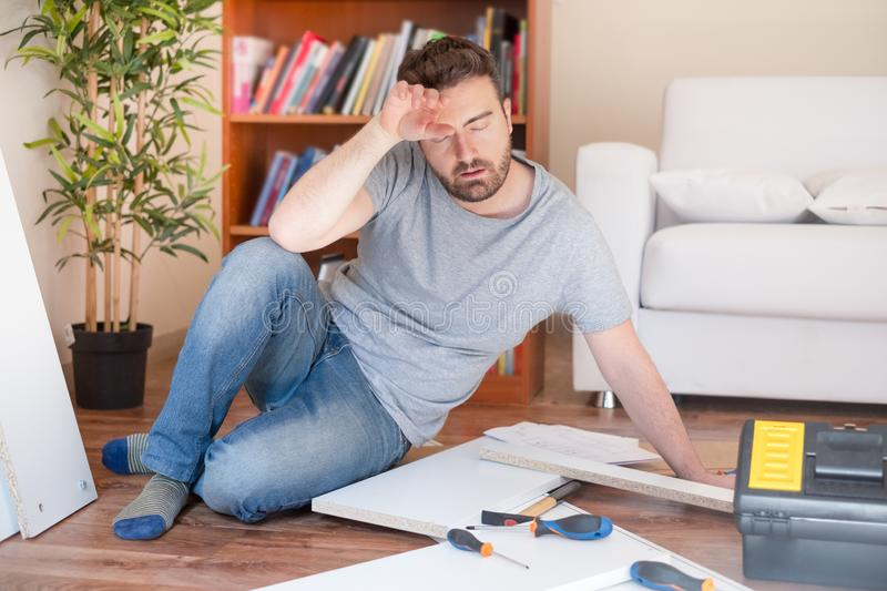 Man portrait and do it yourself furniture assembly stock photos