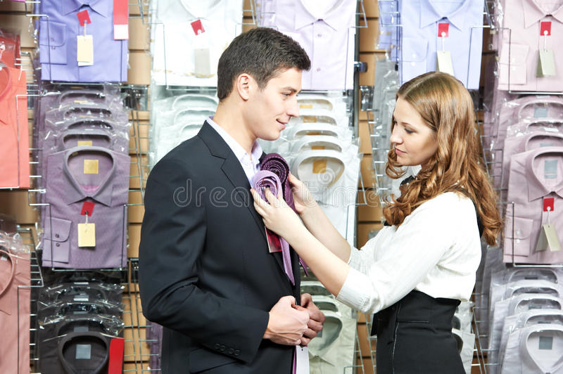 Download Man And Assistant At Apparel Clothes Shopping Stock Image - Image: 24559183