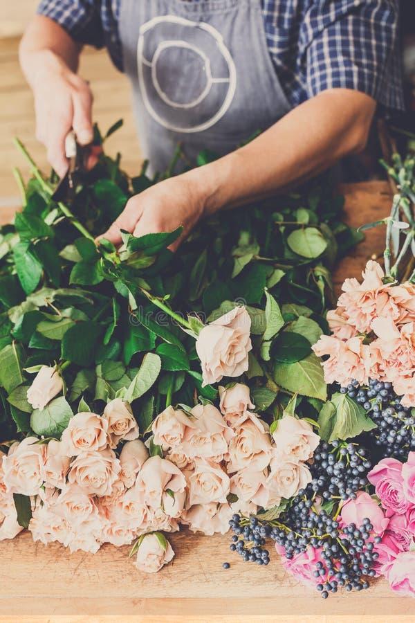 Man Assistant In Flower Shop Delivery Make Rose Bouquet Closeup ...