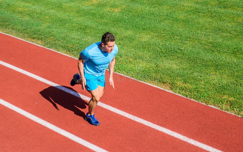 Man athlete run to achieve great result. Speed training guide. Athlete runner sporty shape in motion. Ways to improve royalty free stock photo