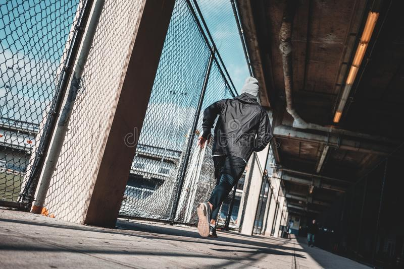 Man athlete running through urban view royalty free stock photography