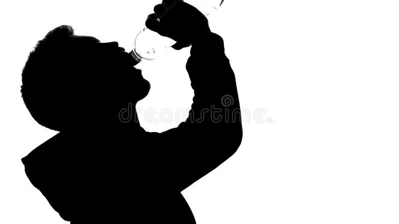 Man athlete shadow drinking water from bottle, healthy lifestyle, aqua balance royalty free stock photo