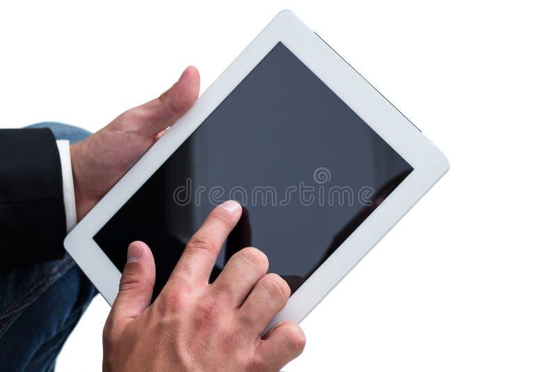 Man att fungera på en tabletPC royaltyfri foto