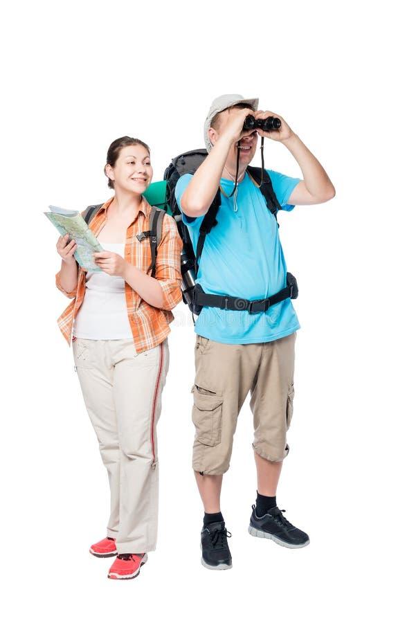 man att se till och med kikarekvinnan som rymmer en översikt isolerad fotografering för bildbyråer