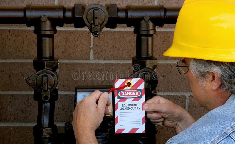 Man attaching lockout tag stock photos