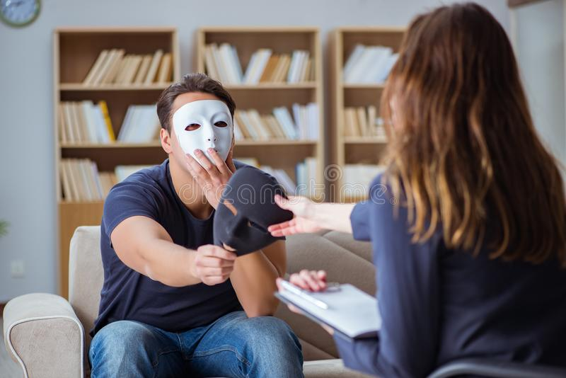 The man attending psychology therapy session with doctor stock photography