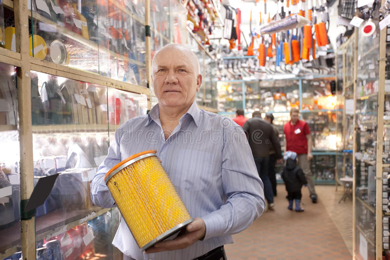 Download Man  in  auto parts store stock image. Image of consumer - 24390991