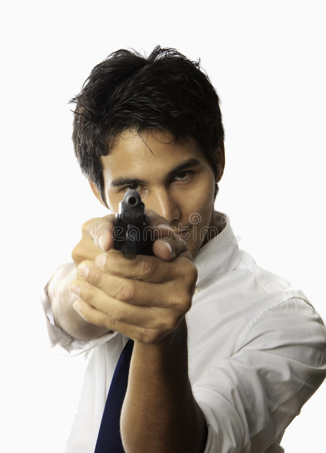 Man with automatic pistol royalty free stock photography