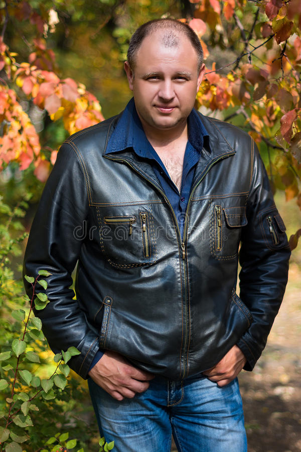 Man in the autumn Park stock photos