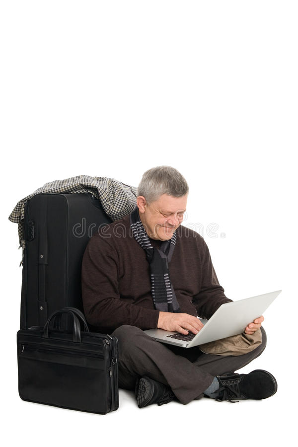 Man awaiting plane for the laptop. Mature man in anticipation of landing on aircraft operating the laptop stock photos