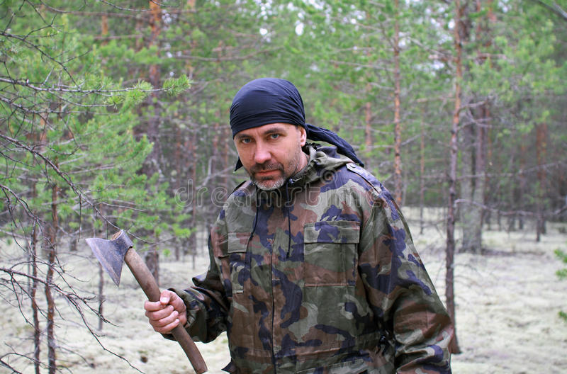 Man With An Ax In The Forest Royalty Free Stock Photography
